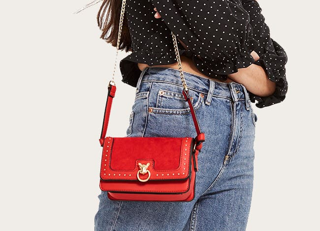 Now carrying: the crossbody. Topshop accessories.