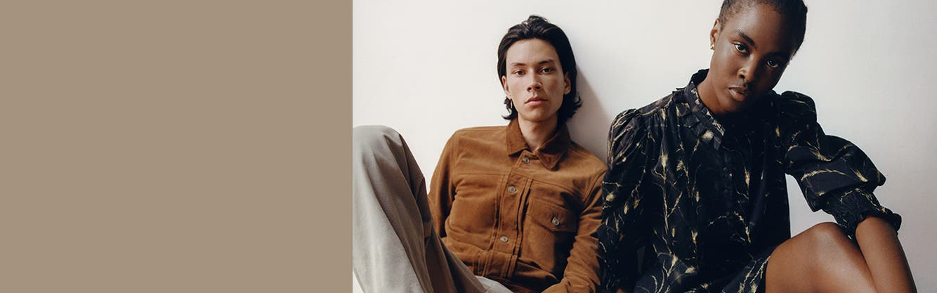 A man and a woman in AllSaints apparel.