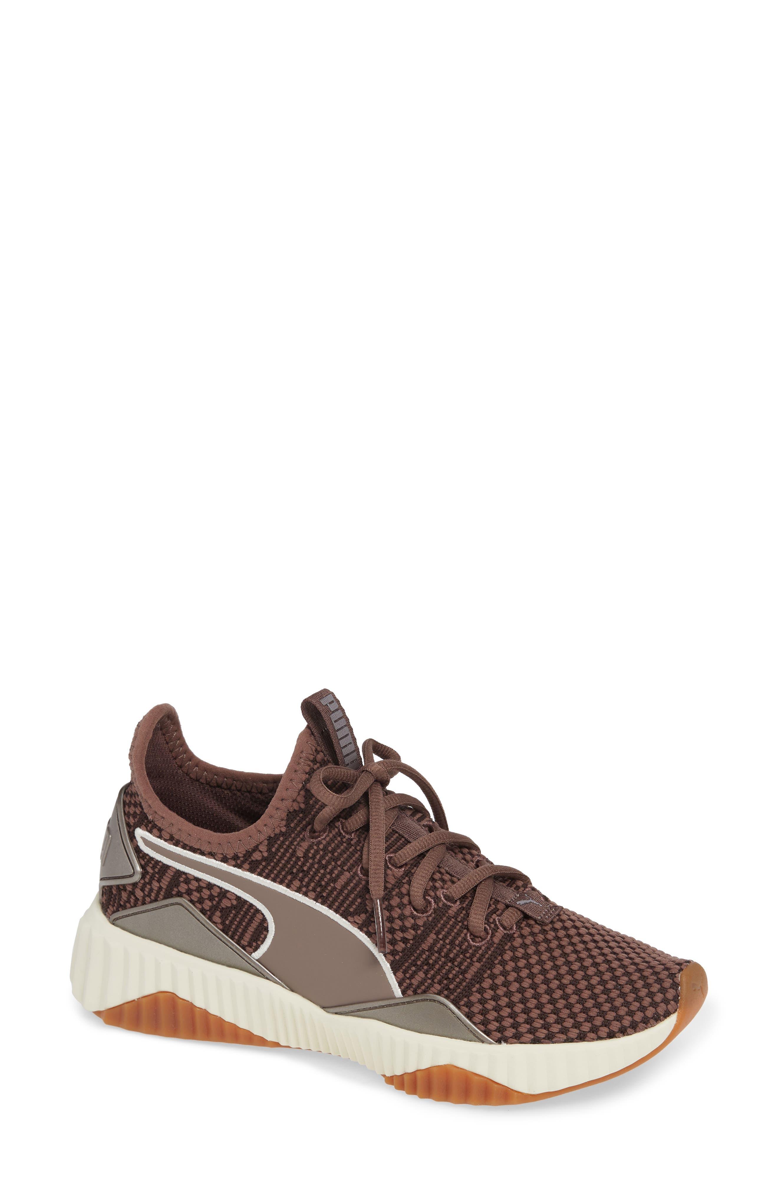 PUMA,                             Defy Luxe Sneaker,                             Main thumbnail 1, color,                             PEPPERCORN/ METALLIC ASH