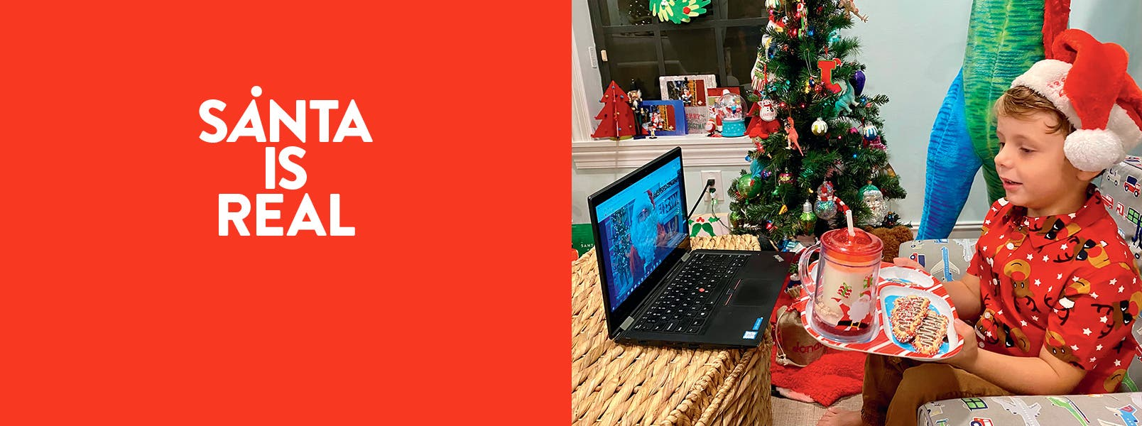 A boy chatting with Santa over a laptop and cookies and milk.