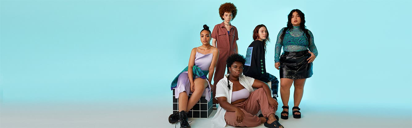 Models wearing BP. WILDFANG outfits: a slipdress and sweater; jumpsuit; bra, shirt and joggers; long-sleeve tee and pants; and top and skirt.