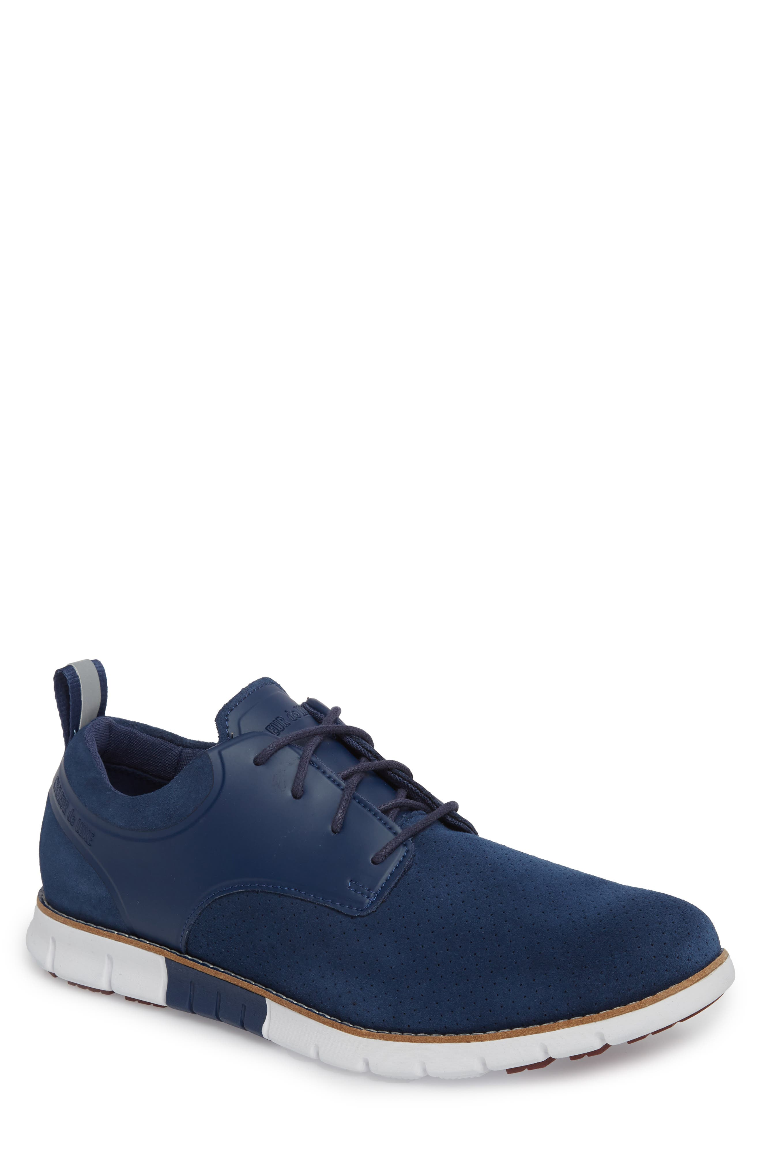 Ridley Perforated Low Top Sneaker,                         Main,                         color, NAVY LEATHER