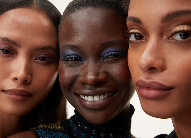 Full focus: models wearing makeup for eyes and lips.