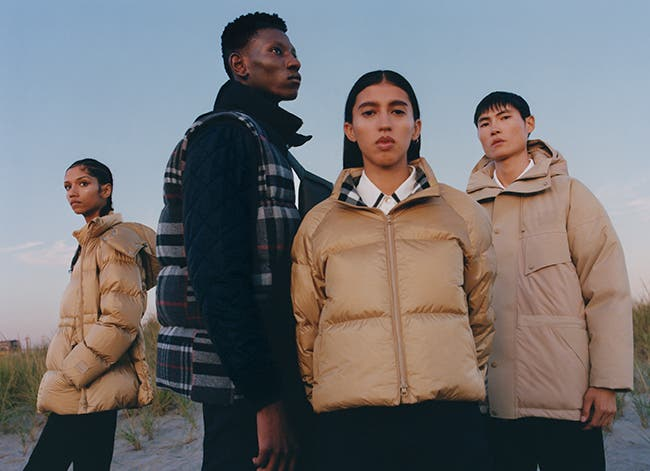Models in Burberry outerwear and accessories.