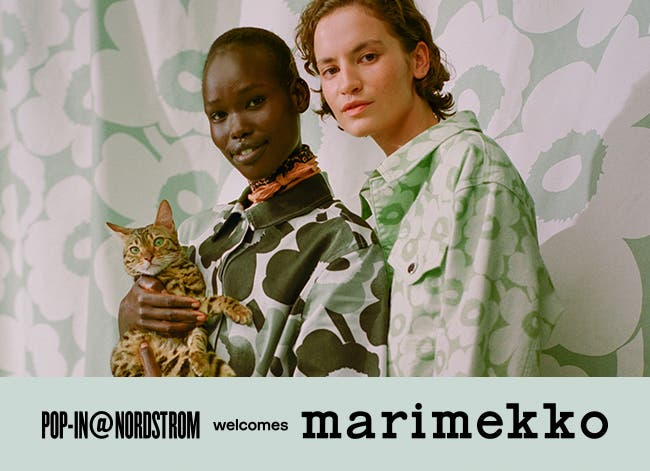 Pop-In at Nordstrom welcomes Marimekko. Women in green floral-print dresses.