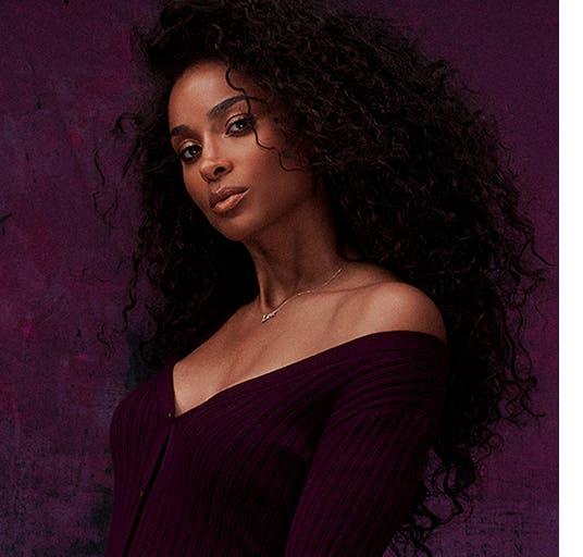 Ciara wears a burgundy V-neck top.