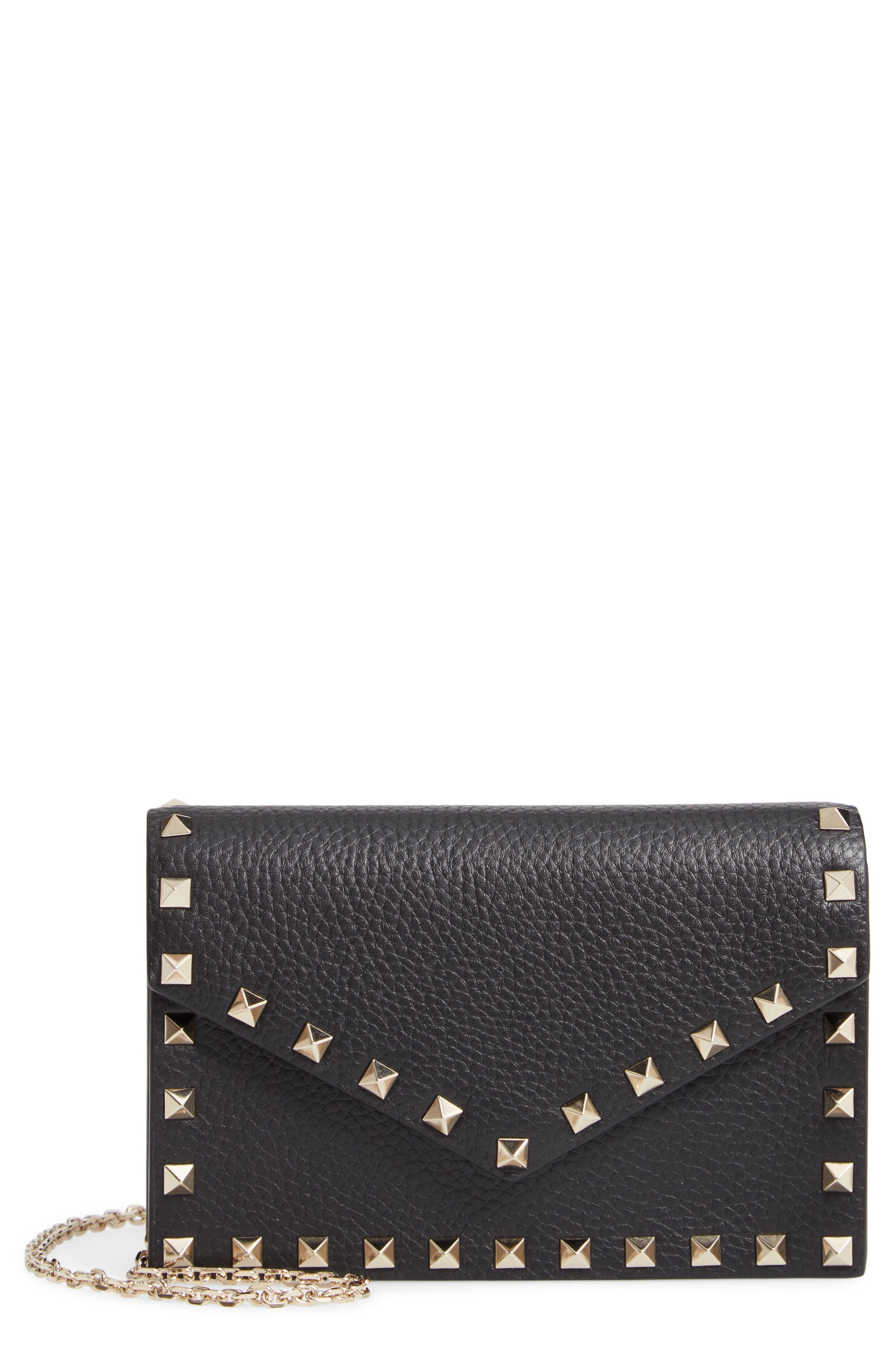 VALENTINO GARAVANI,                             Rockstud Calfskin Leather Envelope Pouch,                             Main thumbnail 1, color,                             NERO