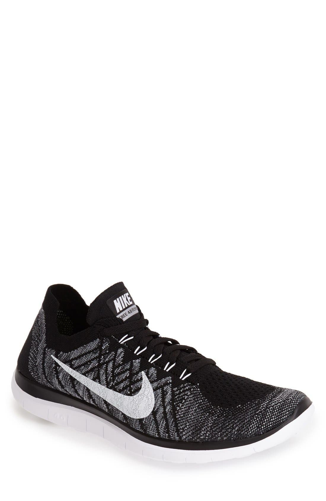 'Free Flyknit 4.0' Running Shoe, Main, color, 001