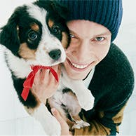 A person holding a puppy.