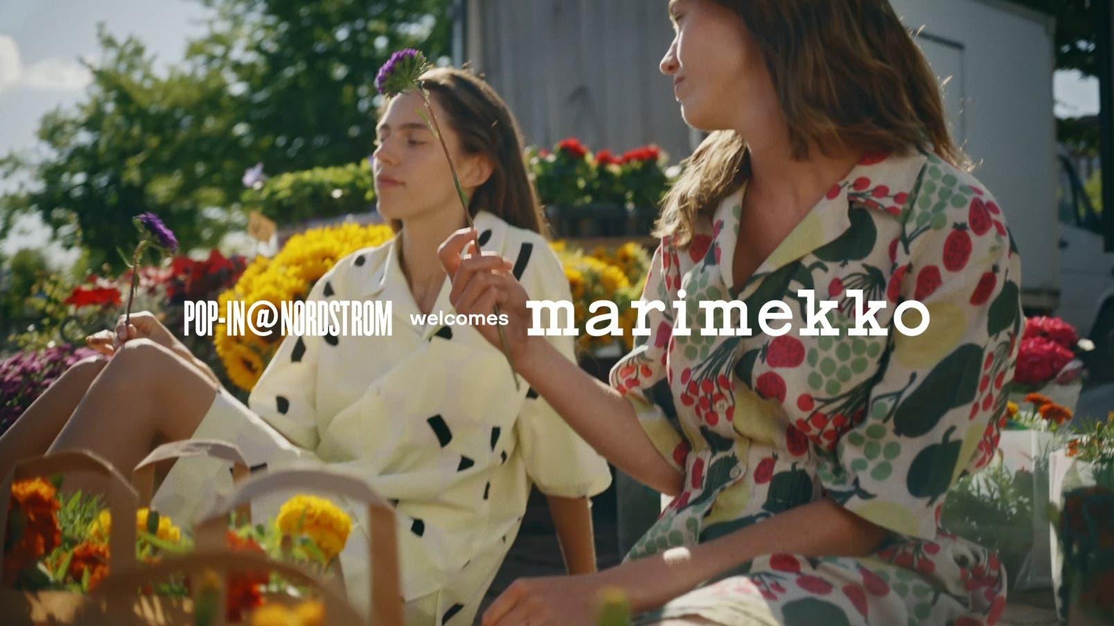 Women wearing printed Marimekko outfits.