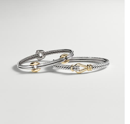 Silver and gold bracelets from the David Yurman Thoroughbred Collection.
