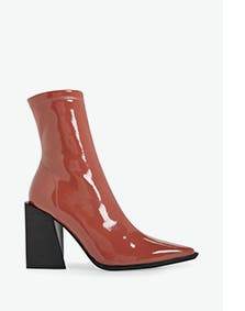 Brown patent high-heel boots for women.