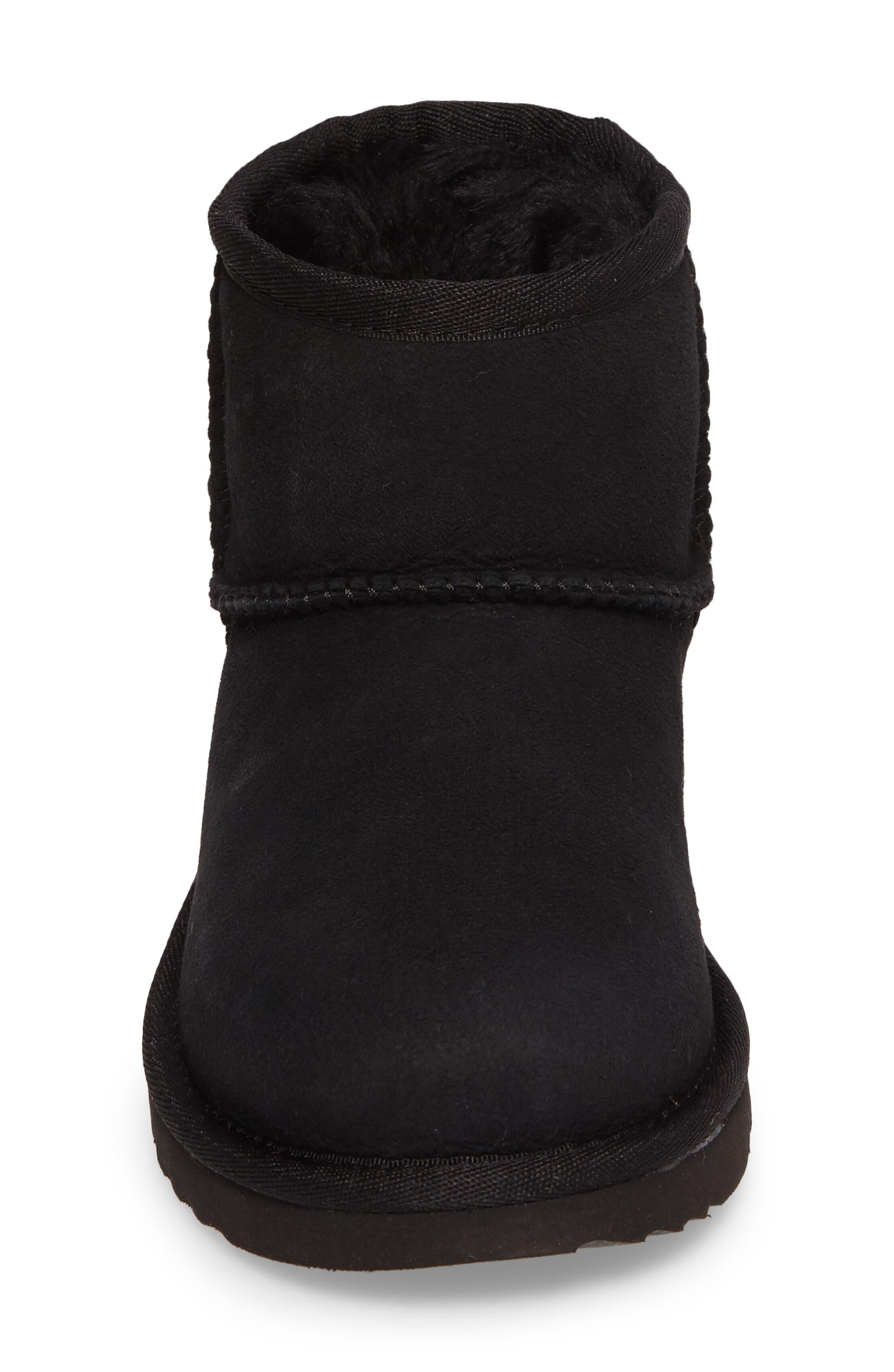 Classic Mini II Water-Resistant Genuine Shearling Boot,                             Alternate thumbnail 4, color,                             BLACK