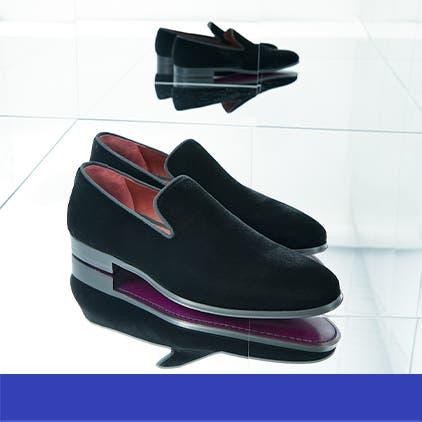 Luxury gifts for him: black velvet loafers.