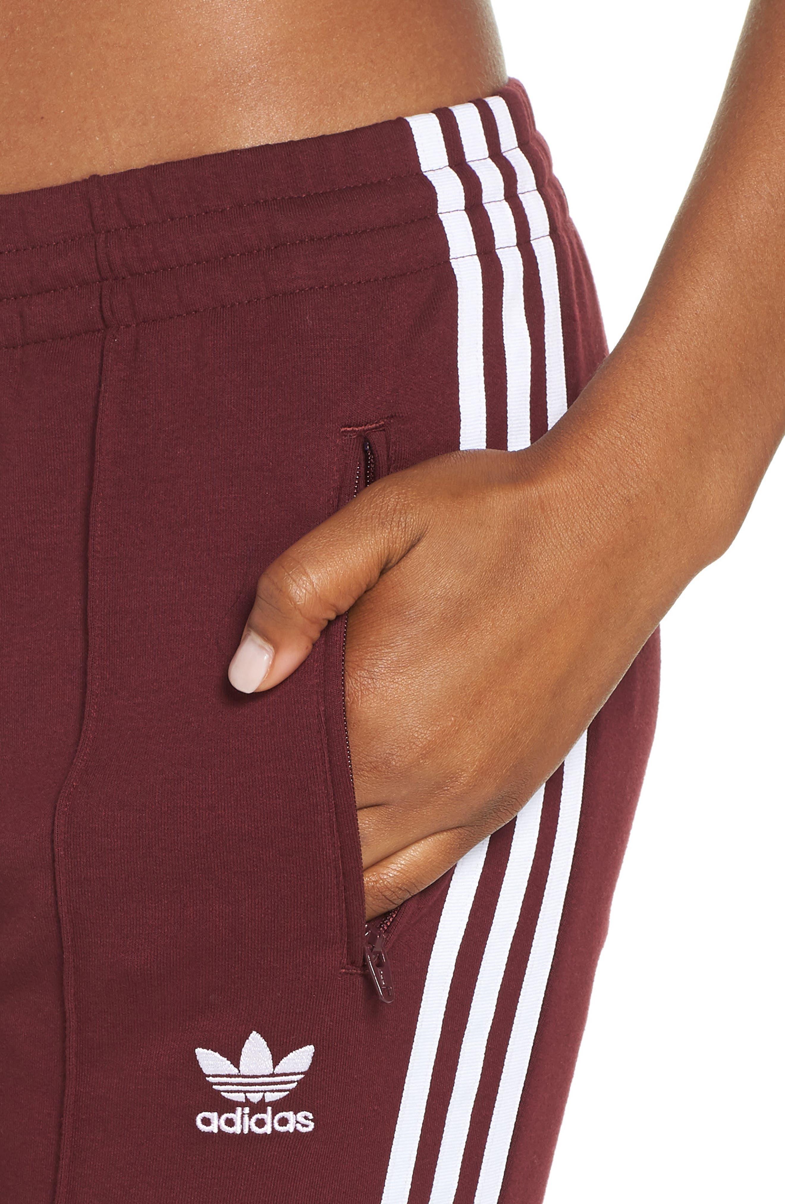 ADIDAS ORIGINALS,                             SST Track Pants,                             Alternate thumbnail 4, color,                             930