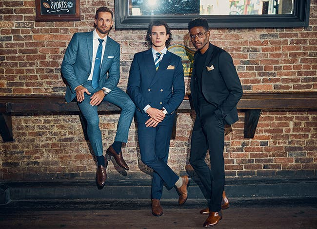 Three men wearing INDOCHINO suits.