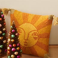 Accent pillow decorated with a sun.
