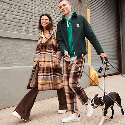 In-store services: a man and woman walking dogs.