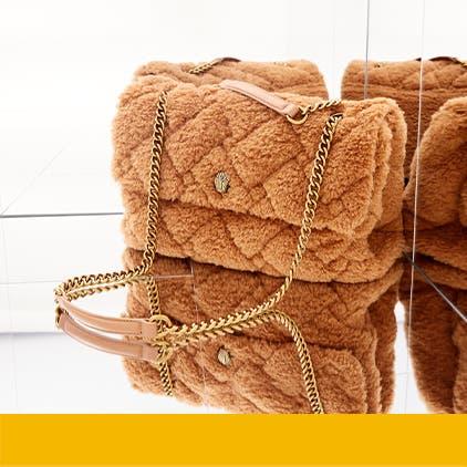Luxury gifts for her: a designer handbag.