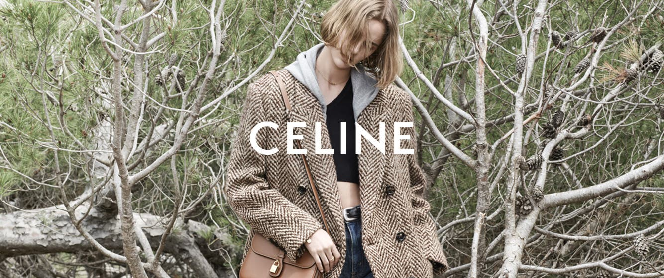 Woman in Celine clothing and accessories.