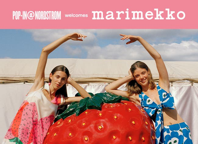 Pop-In at Nordstrom welcomes Marimekko. Woman in a strawberry print dress and woman in a poppy print top and pants.