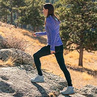 Woman hiking up a hill.