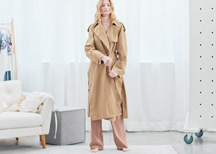Play video to learn how to wear a trench coat.