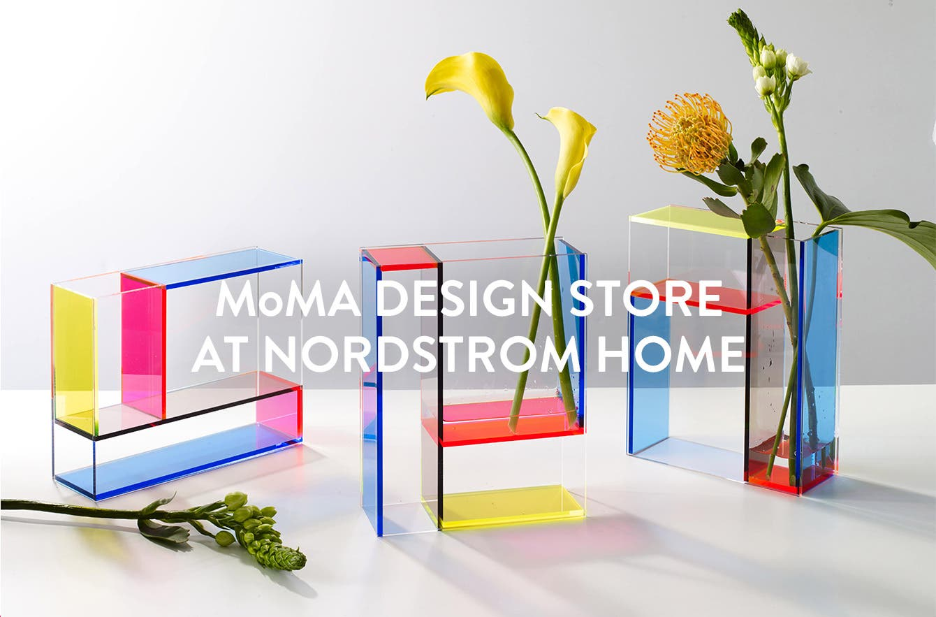 MoMA Design Store at Nordstrom Home. Colorful acrylic vases with flowers and greenery.