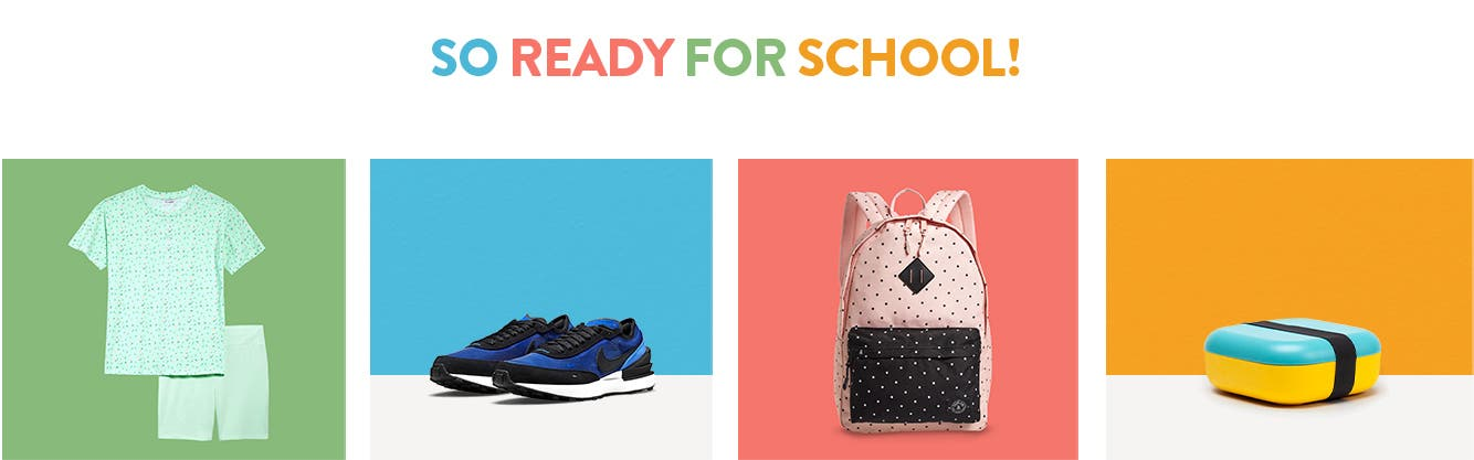 So ready for school! Kids' tee and bike short set, sneakers, backpack and bento box for lunch.