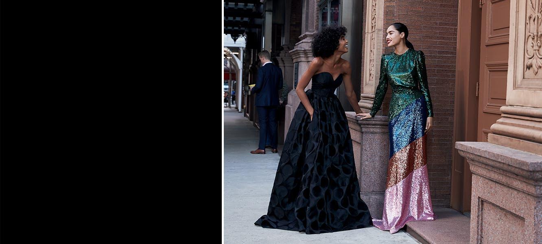 Models wearing women's  designer fall clothing.