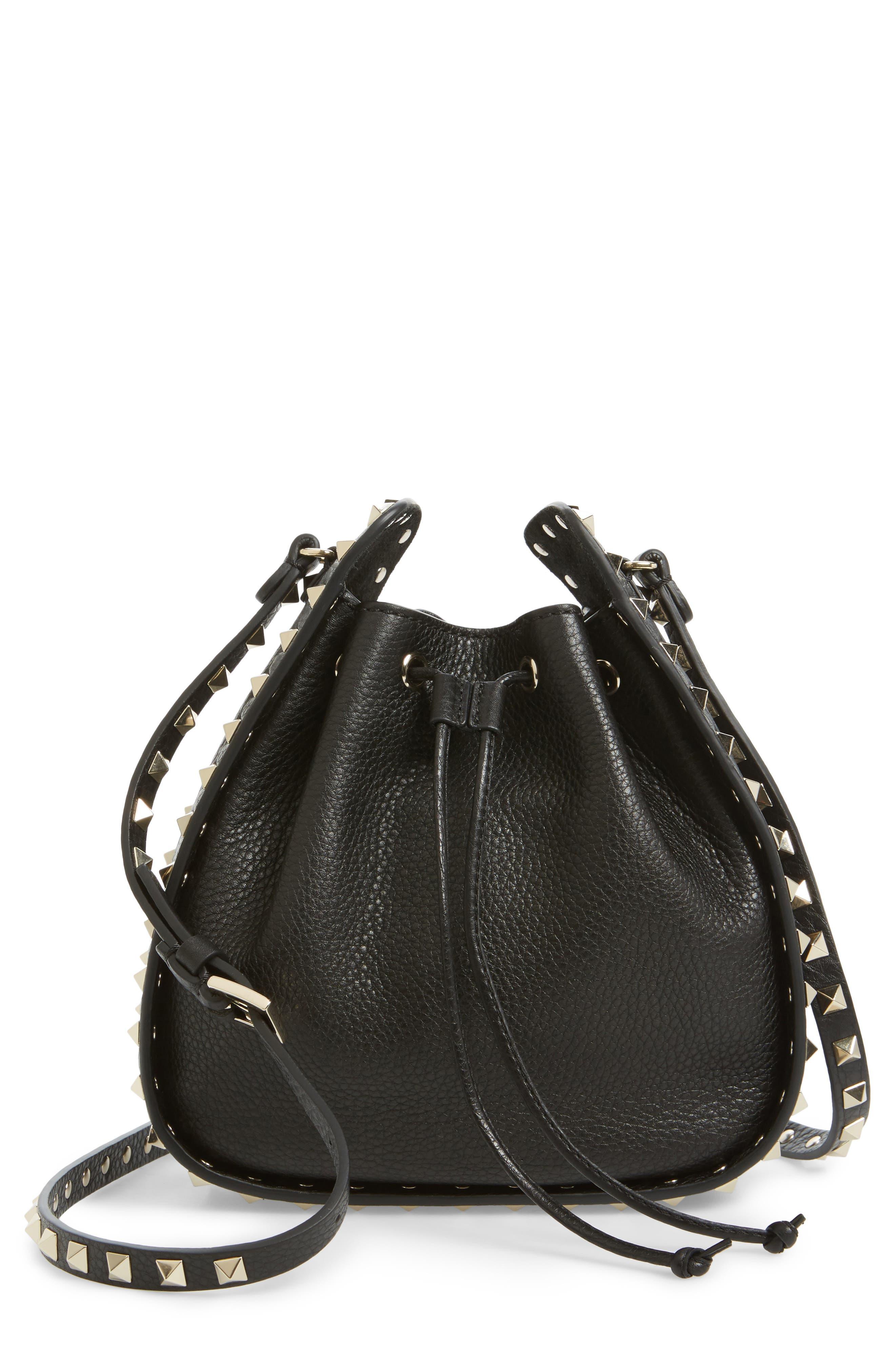 VALENTINO GARAVANI,                             Rockstud Leather Bucket Bag,                             Main thumbnail 1, color,                             001