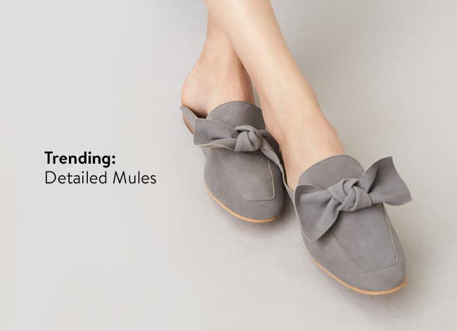 Women's mules and slides with feminine details.