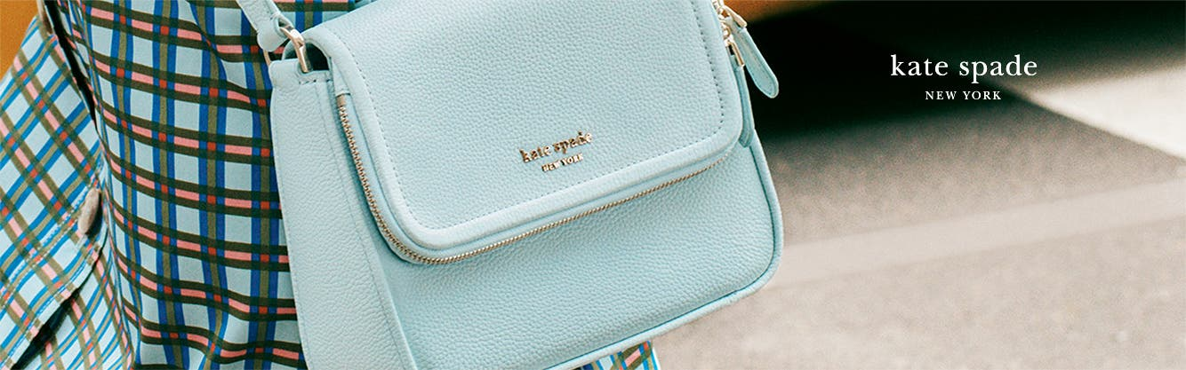 A blue kate spade new york handbag.