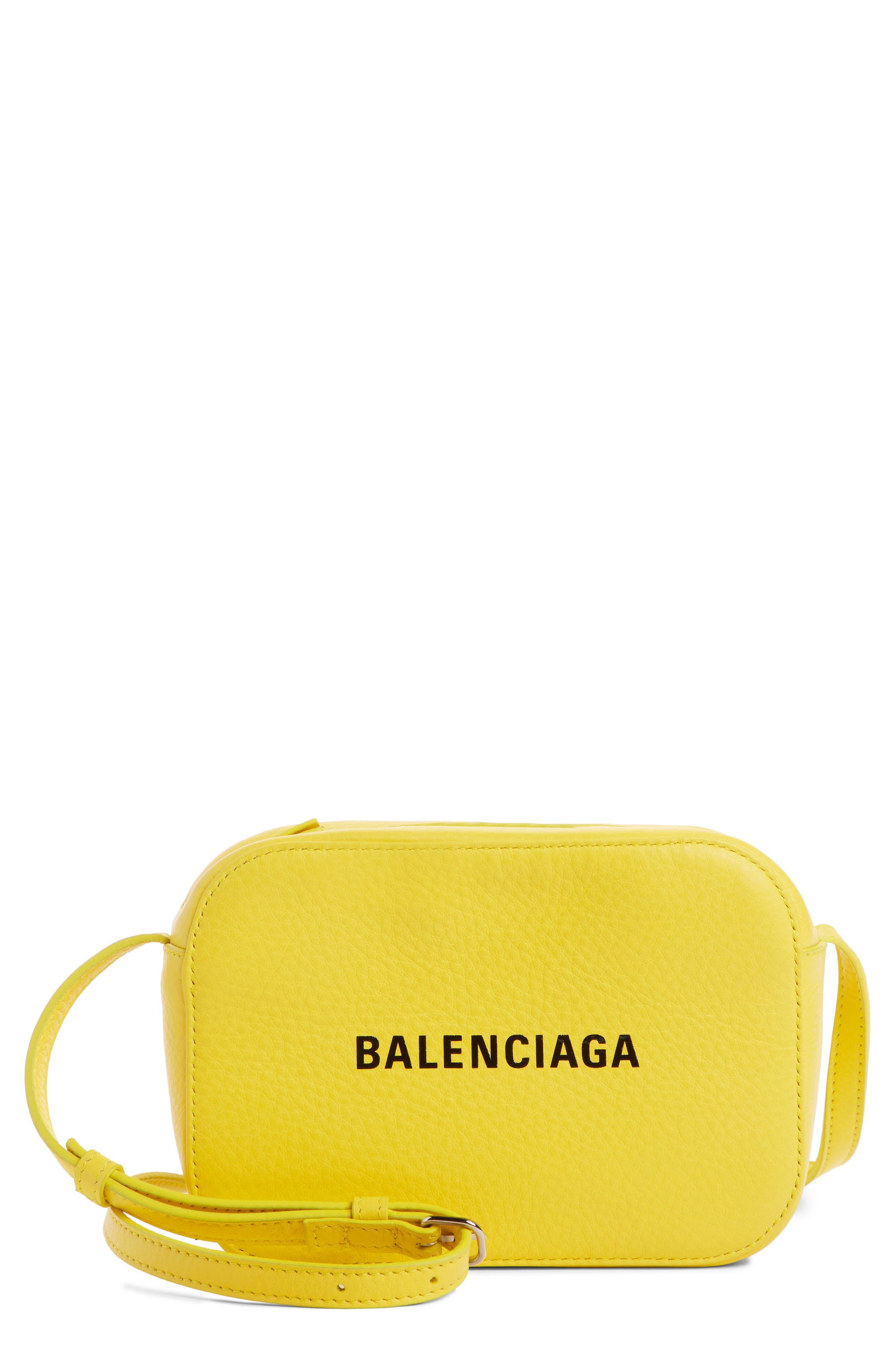 BALENCIAGA,                             Extra Small Everyday Calfskin Camera Bag,                             Main thumbnail 1, color,                             JAUNE SOLEIL/ NOIR