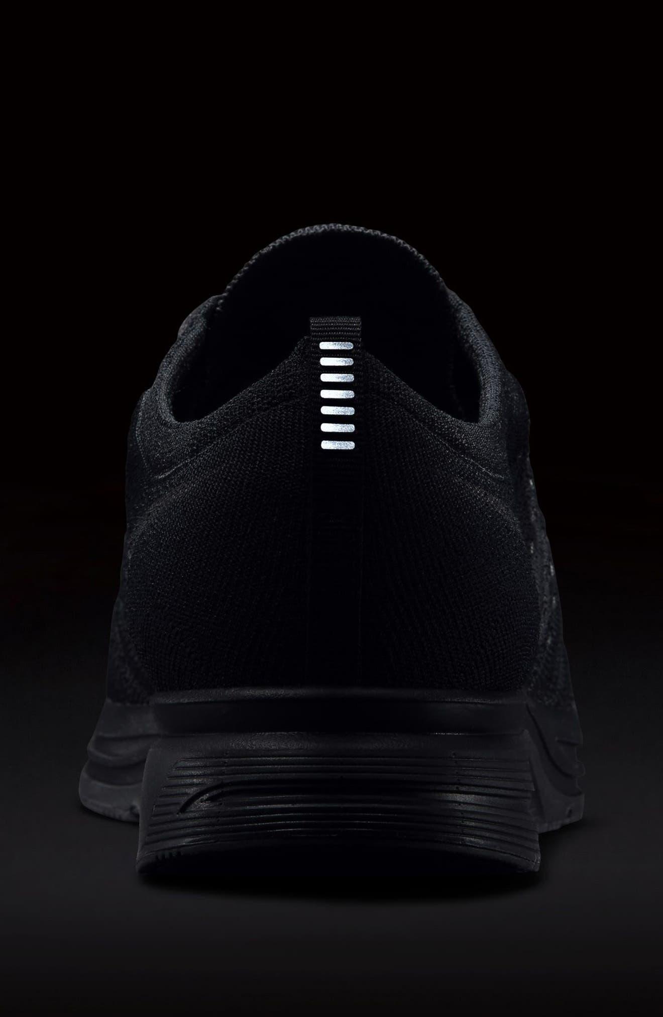 NIKE,                             Flyknit Trainer Sneaker,                             Alternate thumbnail 7, color,                             004