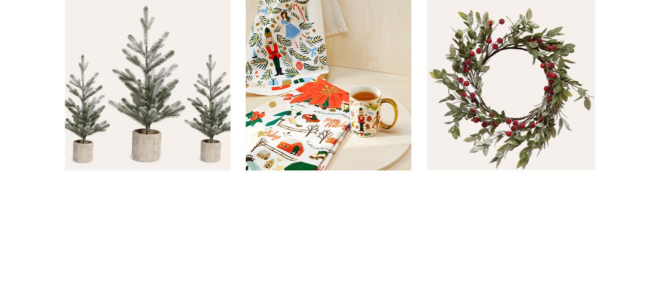 Artificial Christmas trees. A Nutcracker mug and holiday tea towels. A wreath of berries and greenery.