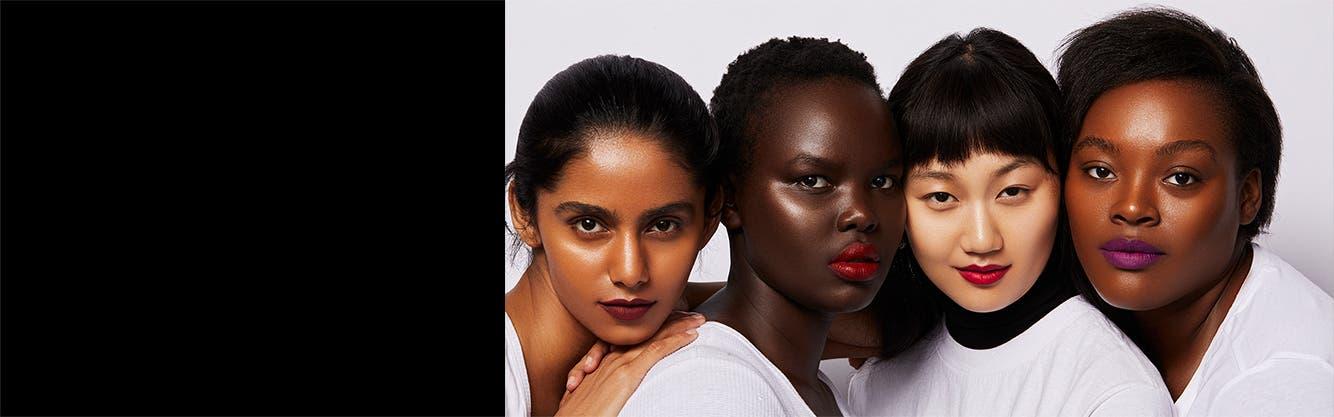 Women wearing UOMA Beauty makeup.