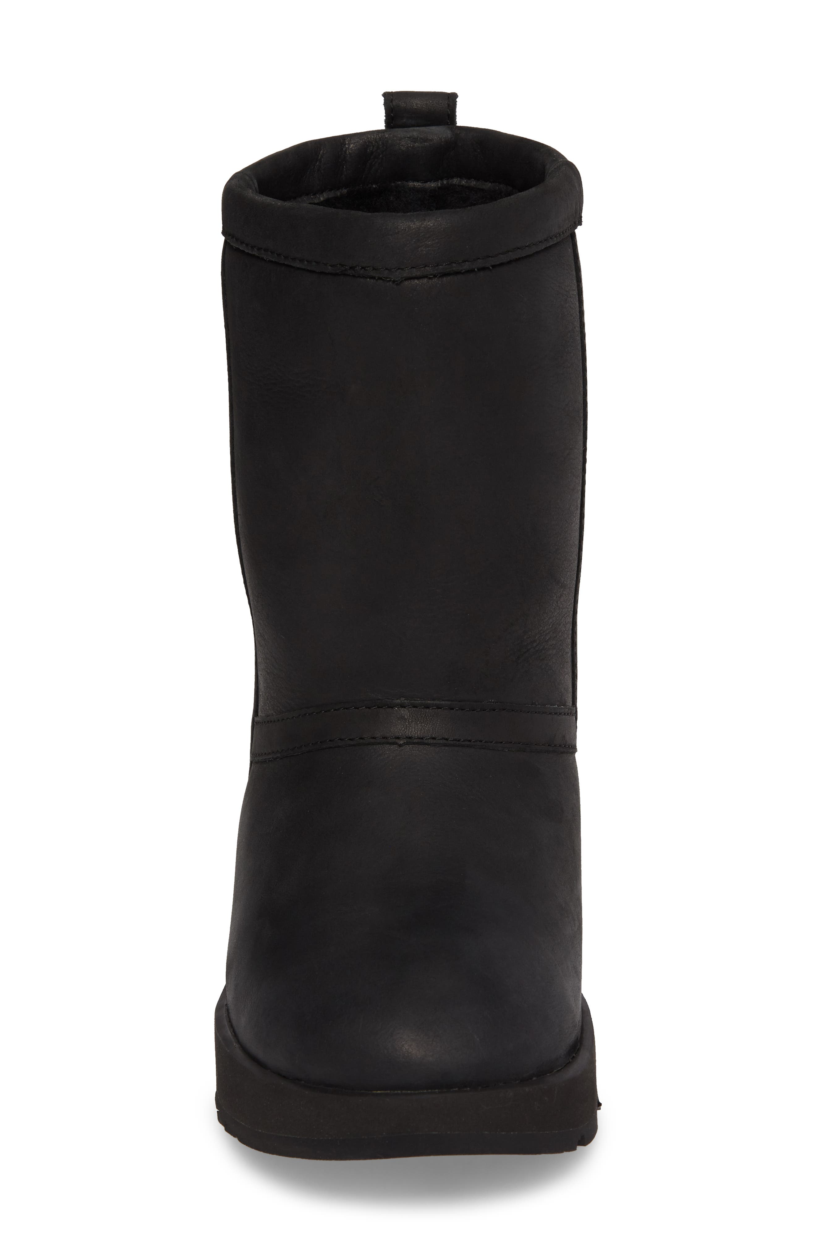UGG<SUP>®</SUP>,                             Classic Genuine Shearling Lined Short Waterproof Boot,                             Alternate thumbnail 4, color,                             BLACK LEATHER