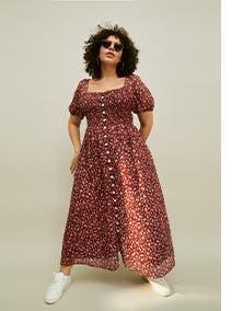 Woman wearing a printed maxi dress.