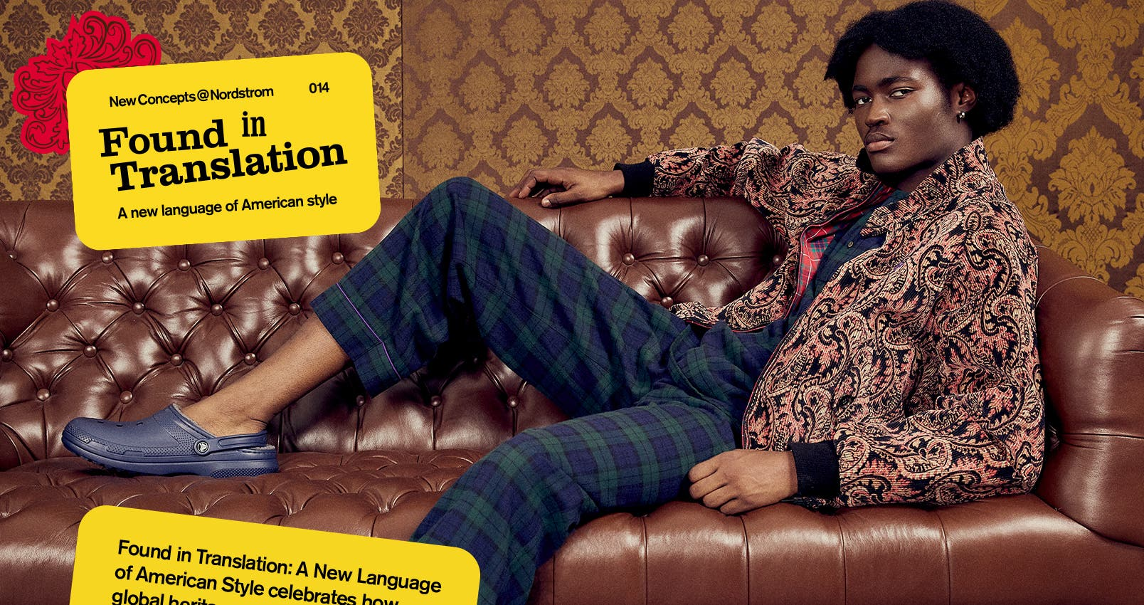 NewConcepts@Nordstrom: Found in Translation—A New Language of American Style. A man on a leather couch in a paisley textured jacket over plaid top and pants. Also in a multicolored patchwork coat over a loose-knit sweater, standing in the woods.