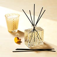 A scented candle and diffuser.