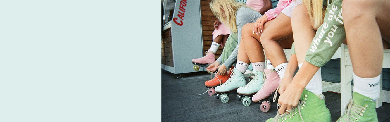 Women in roller skates wear matched sets from the WAYF '98 collection.