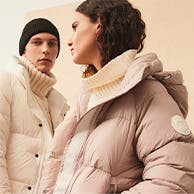 Man and woman in puffer jackets.
