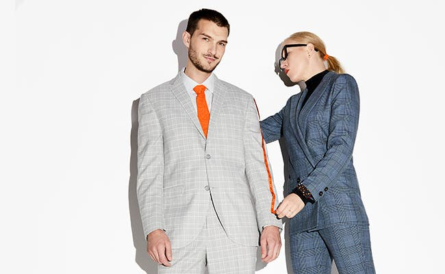 A man getting a suit altered