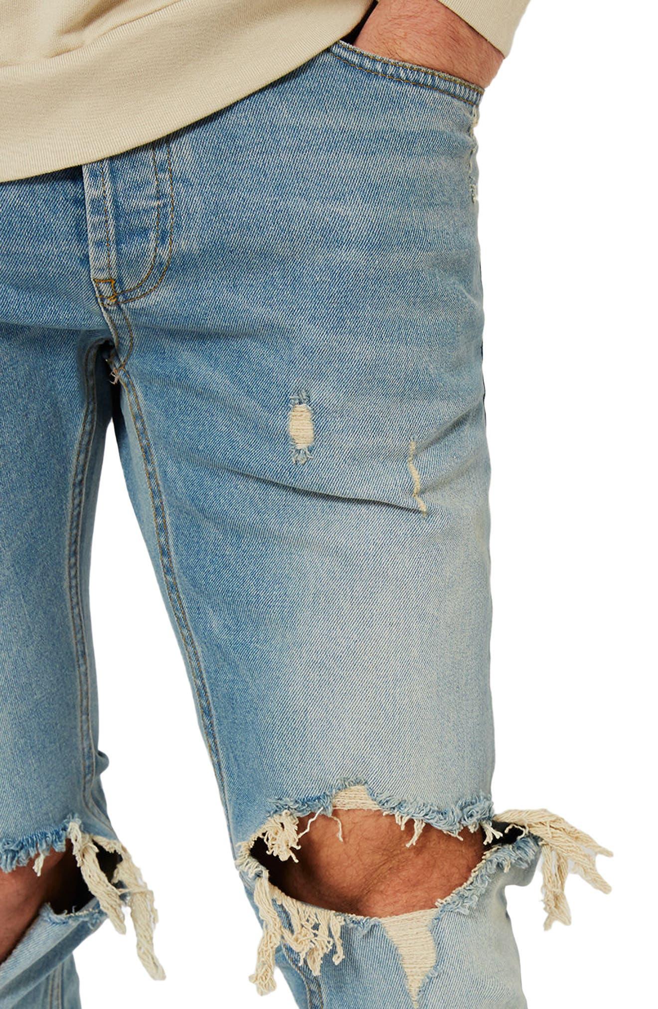 Ripped Stretch Skinny Jeans,                             Alternate thumbnail 4, color,                             LIGHT WASH DENIM
