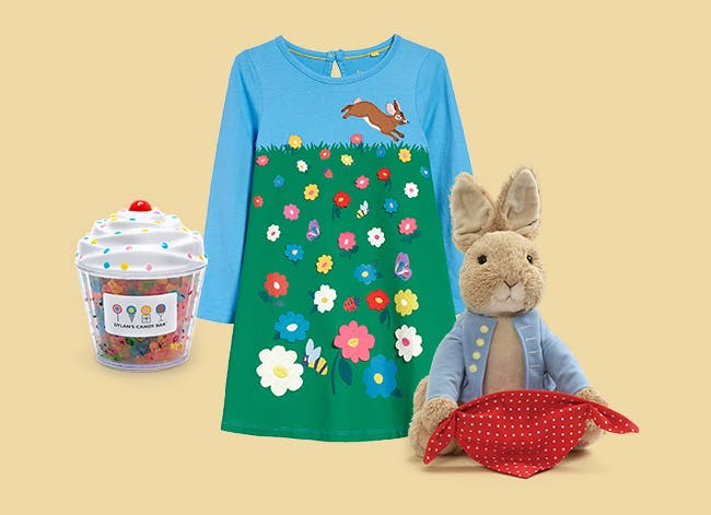 Dylan's Candy Bar gummy bears, Mini Boden girls dress and stuffed rabbit toy.
