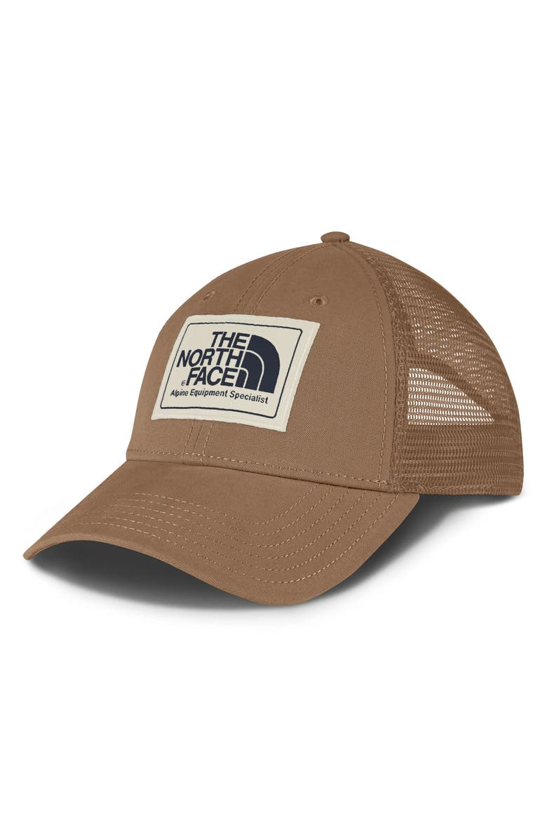 3193afec120 A giant logo patch fronts the crown of a classic trucker hat styled with a  curved brim and a breathable mesh back.