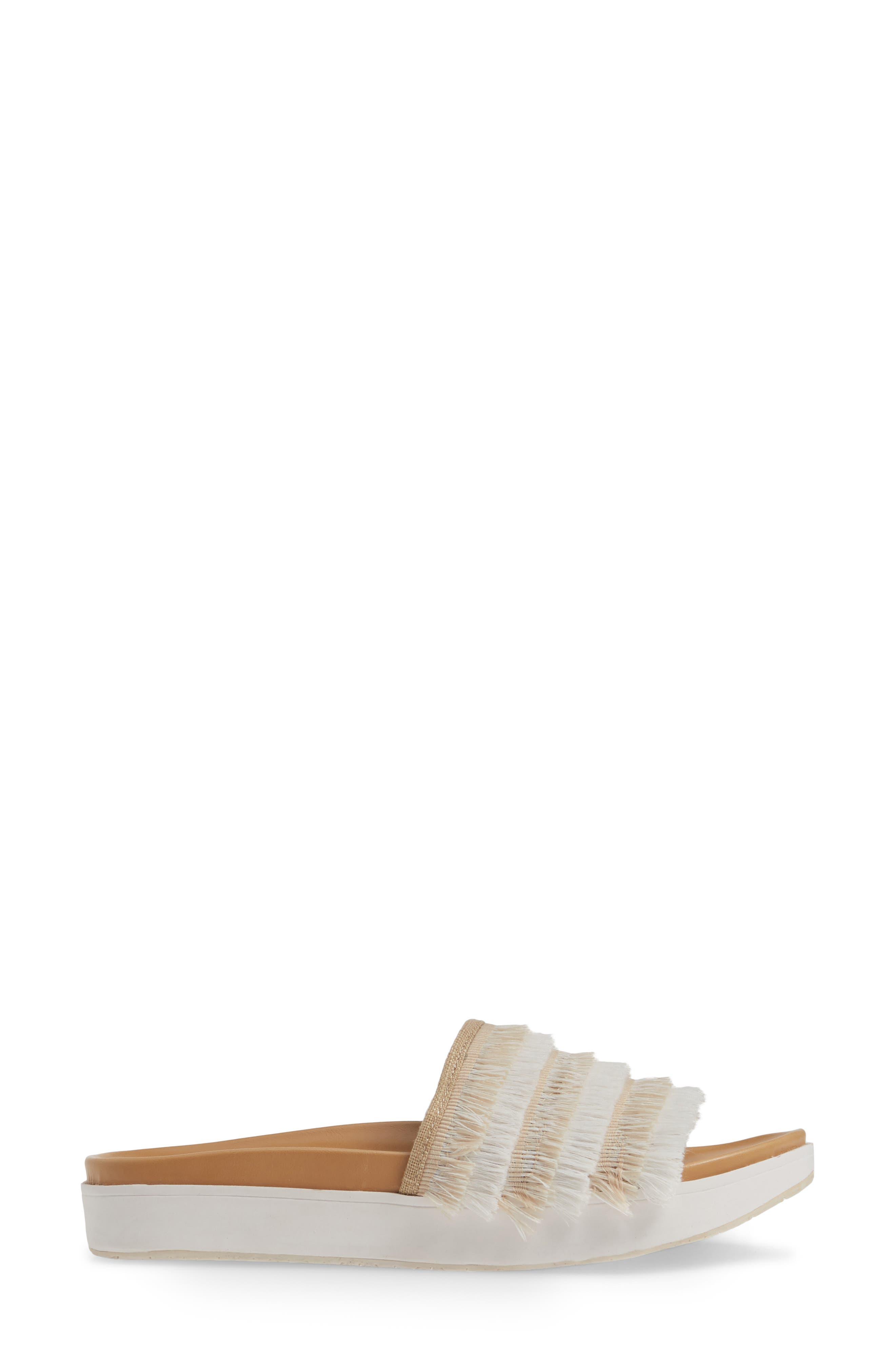 MINNETONKA, x Lottie Moss Ashlynn Fringe Slide Sandal, Alternate thumbnail 3, color, TAUPE