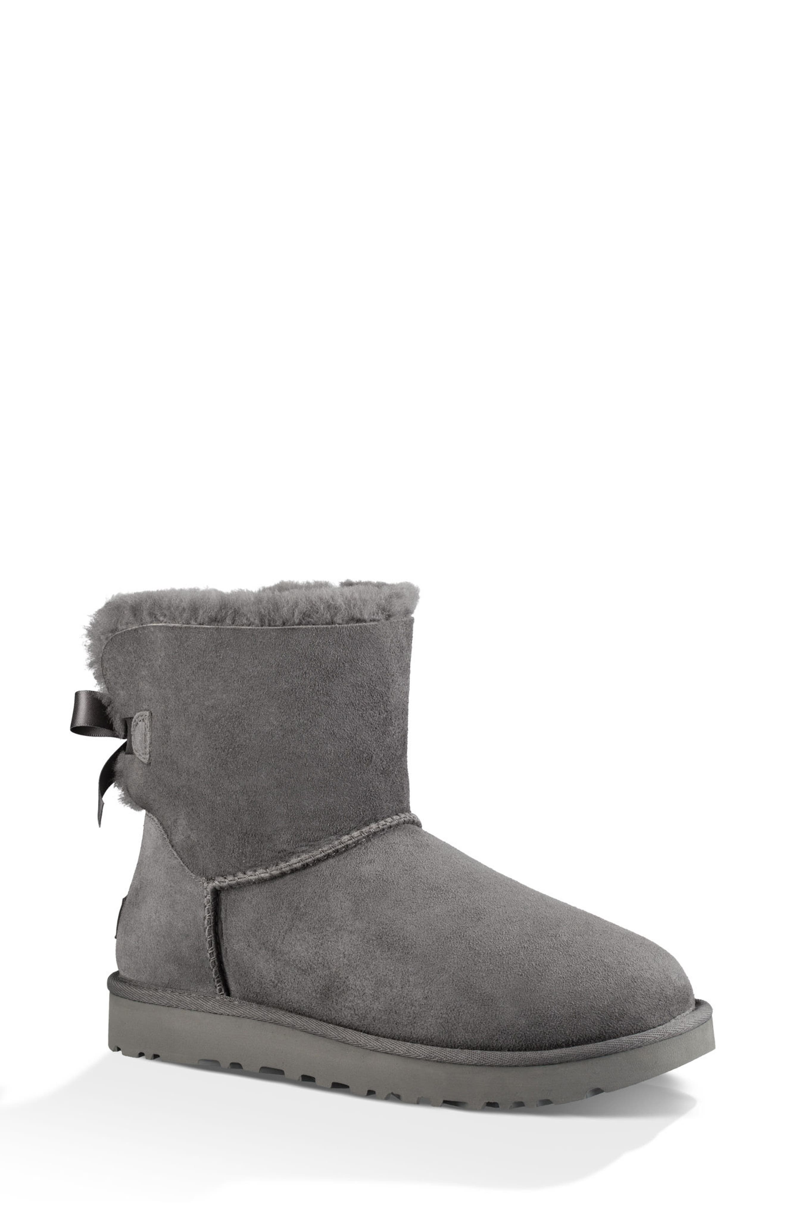 UGG<SUP>®</SUP>, Mini Bailey Bow II Genuine Shearling Bootie, Main thumbnail 1, color, GREY SUEDE