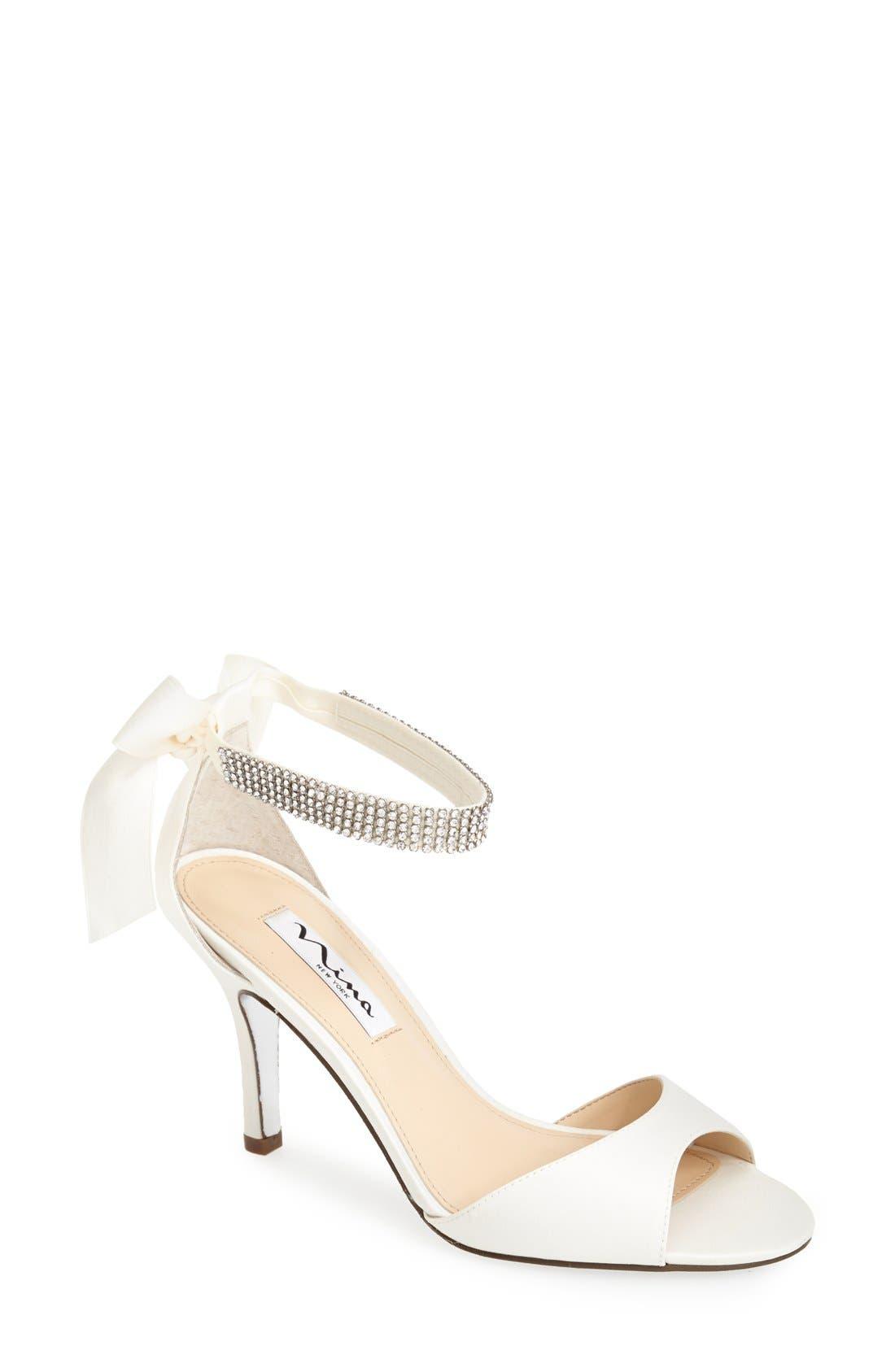 NINA, 'Vinnie' Crystal Embellished Ankle Strap Sandal, Main thumbnail 1, color, IVORY